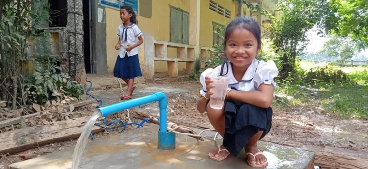 girl-at-water-well-cambodia-rock-foundation-clean-water