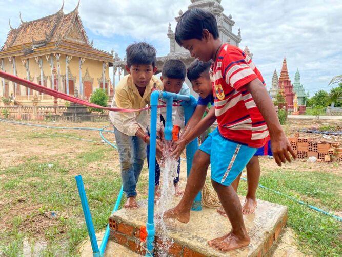 rock-foundation-cambodia-fresh-water-wells-children-drinking